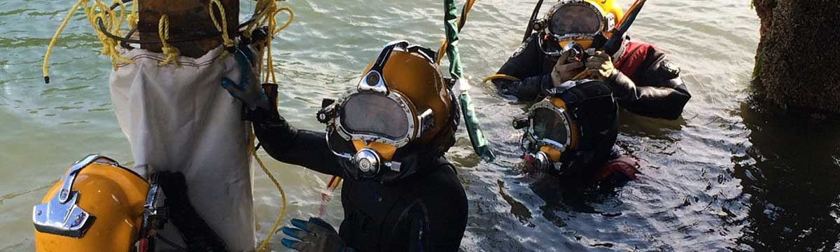 Military divers prepare for an underwater concrete pour to repair a damaged pile