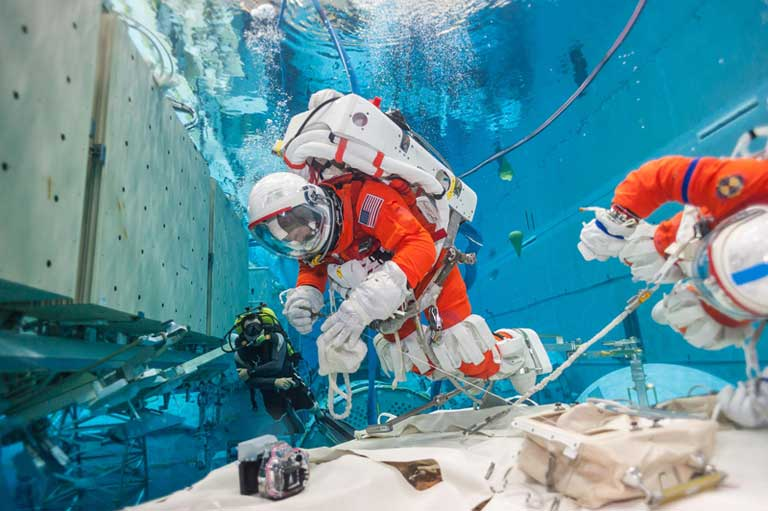 NASA Astronauts training in the NBL environment.